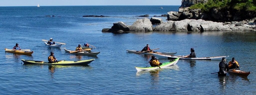 Sea kayakers learning Greenland-style paddling