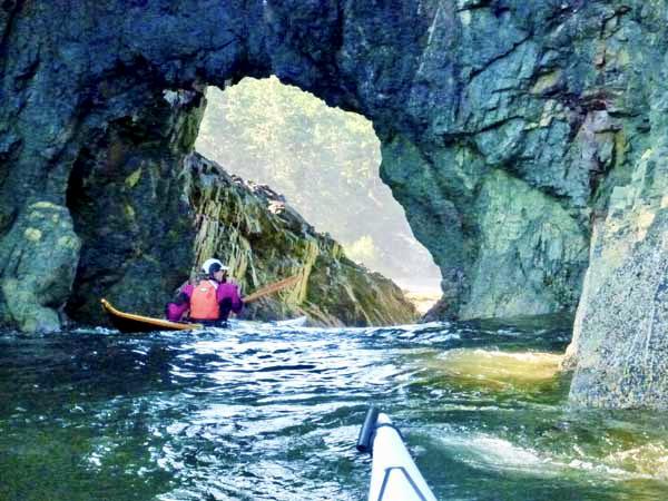 Sea Kayaking through an Arch